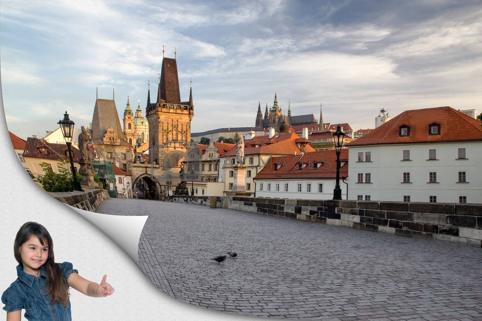 Cute tanned little girl standing in an exposed corner is pointing at empty famous Charles Bridge in Prague. Czech Republic. Ready for your text.