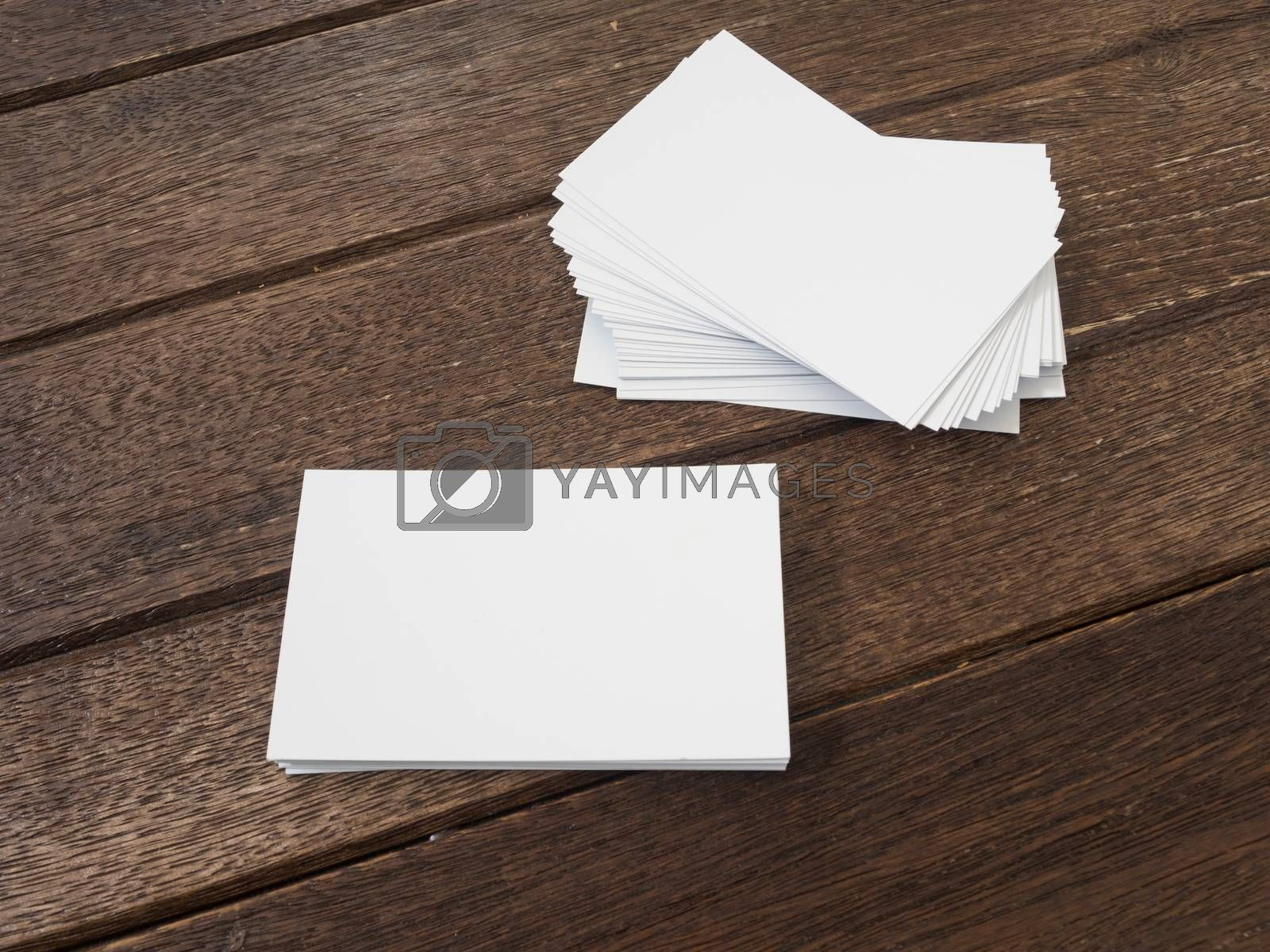 business card placed on a wooden table