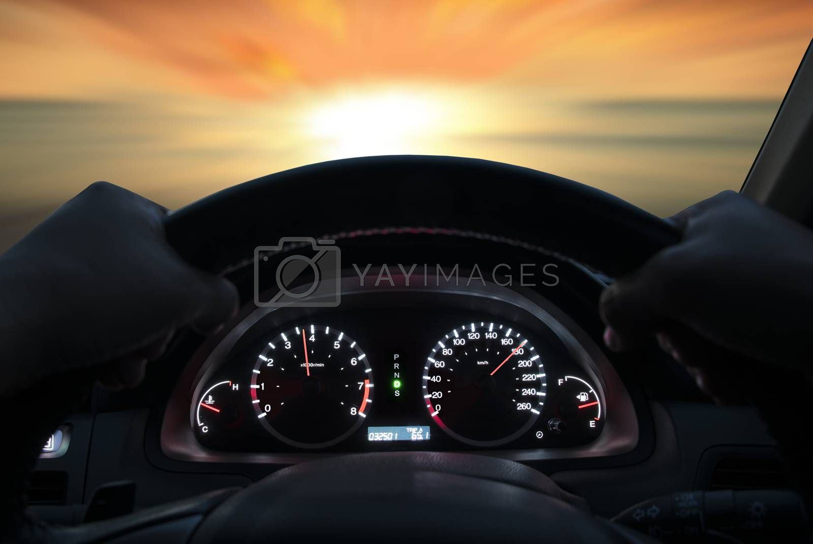 Speed driving at 180 km/h on the road at sunset.