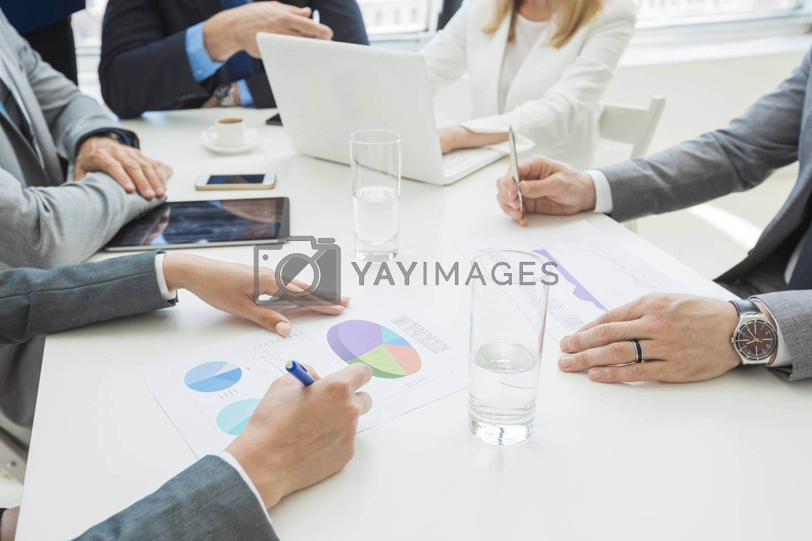 Team of business people at meeting in office discuss financial documents and statistics data