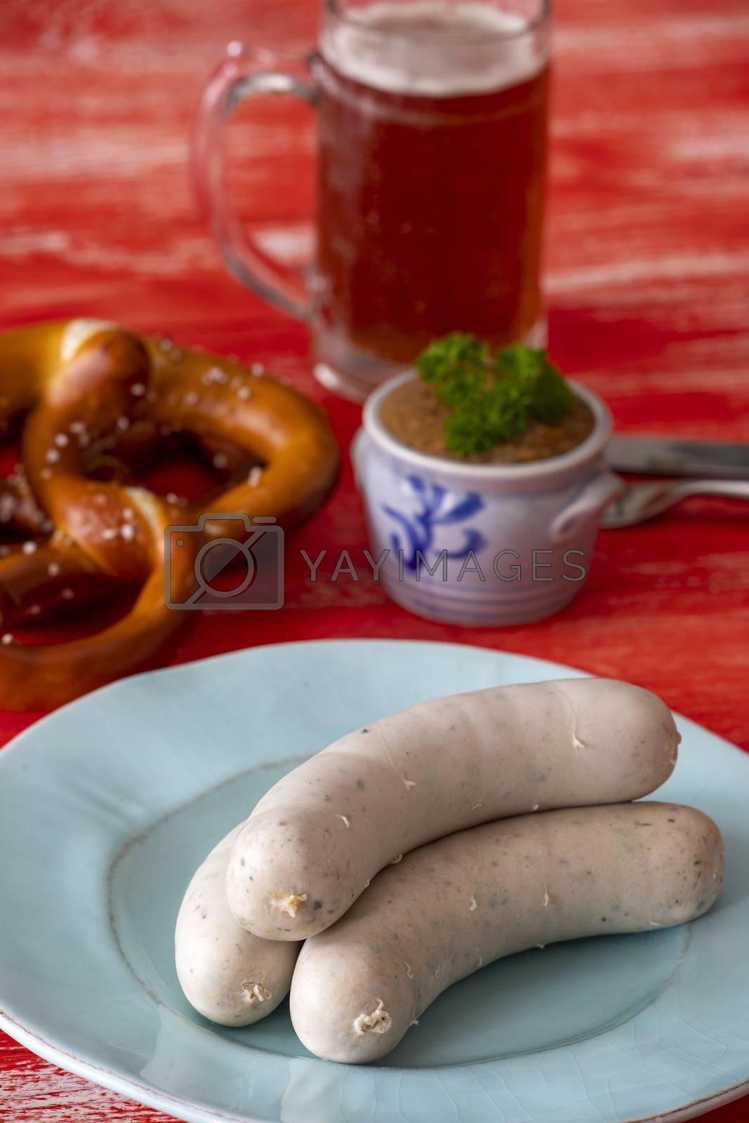 bavarian white sausage on red background