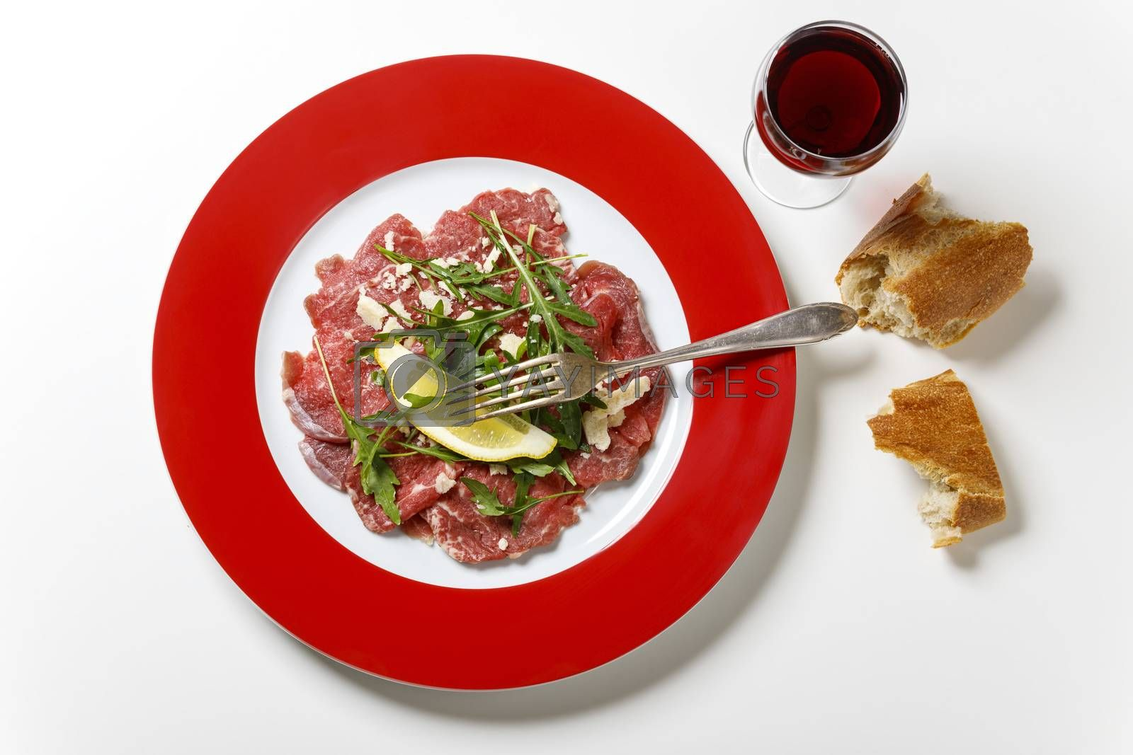 fresh carpaccio with rucola on a plate