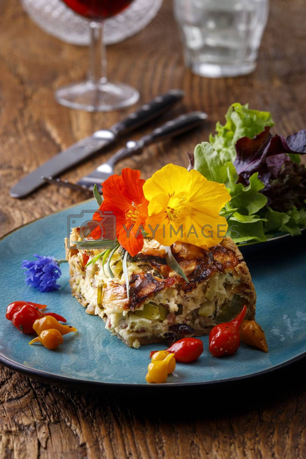 piece of french quiche with salad