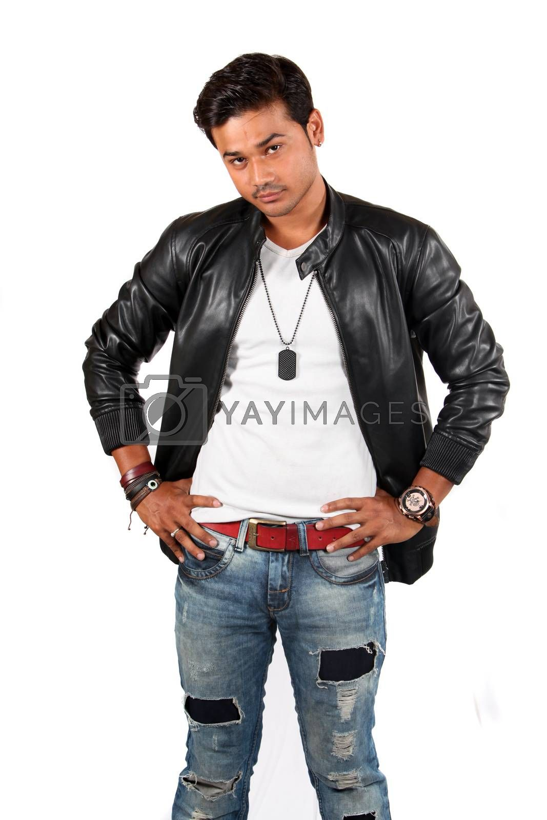 A confident looking young Indian guy, on white studio background.