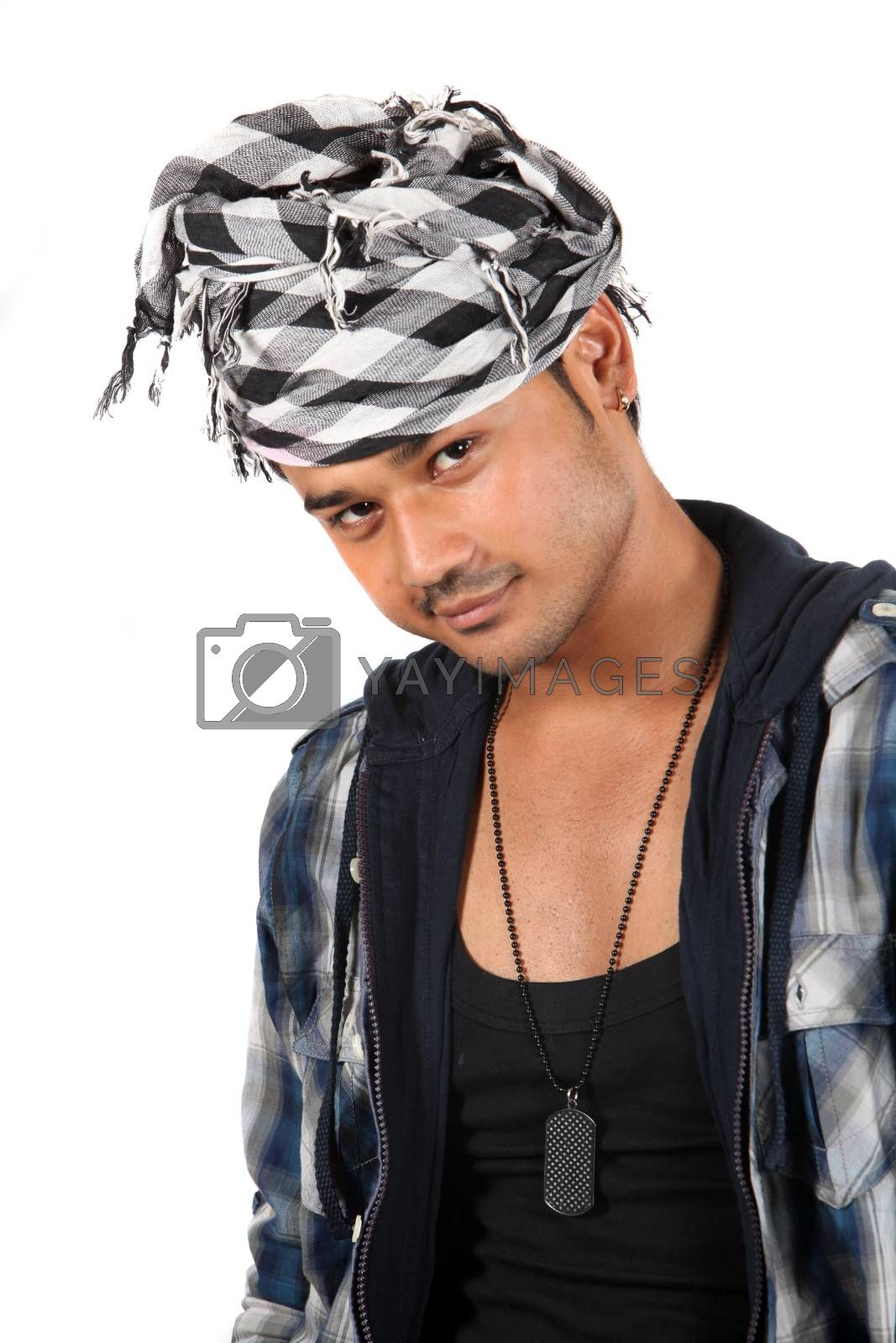 A handsome young Indian guy with a style, on white studio background.