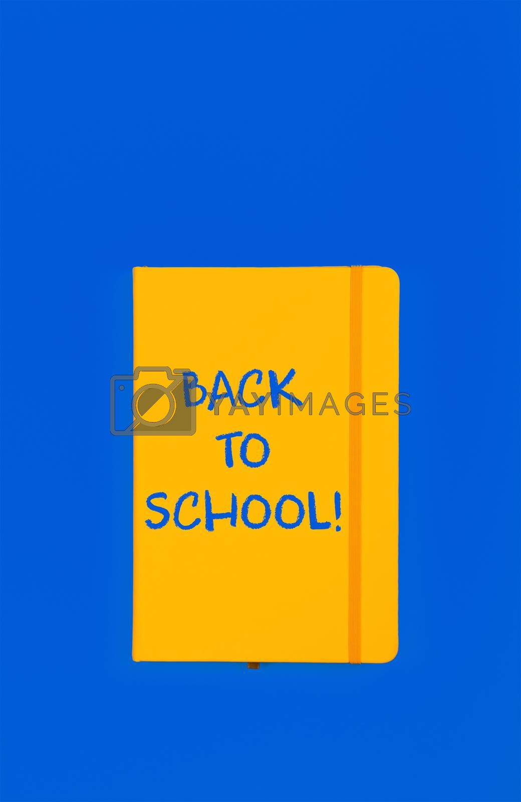 Back to school sign on yellow notebook by BreakingTheWalls