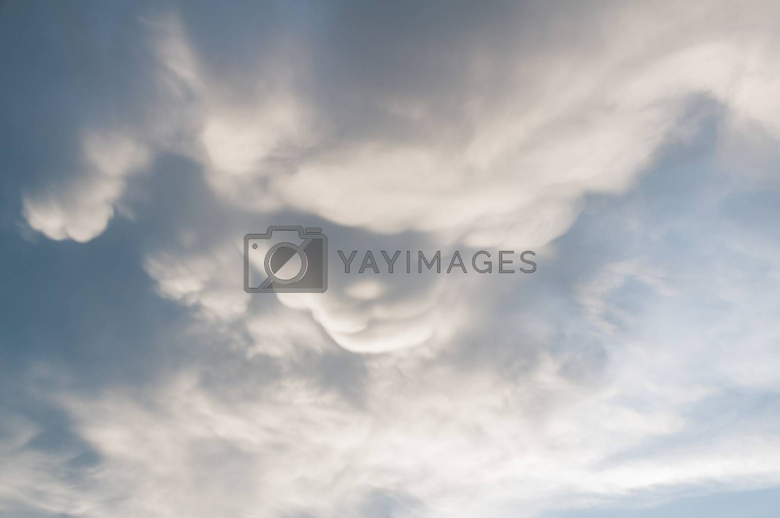 Moving Storm Cloud under the Sunlight shining before Heavy Rain as Concept of Natural disease or Monsoon Hurricane in Rainy season