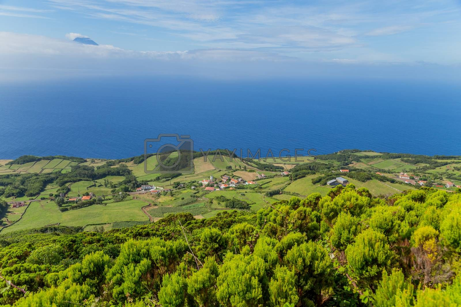 View of the Sao Jorge countryside with the Pico island on the background. Azores, Portugal