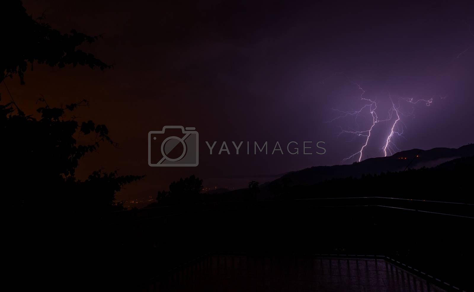 Lightning bolts during an evening thunderstorm over Geres National Park, Amares, Portugal