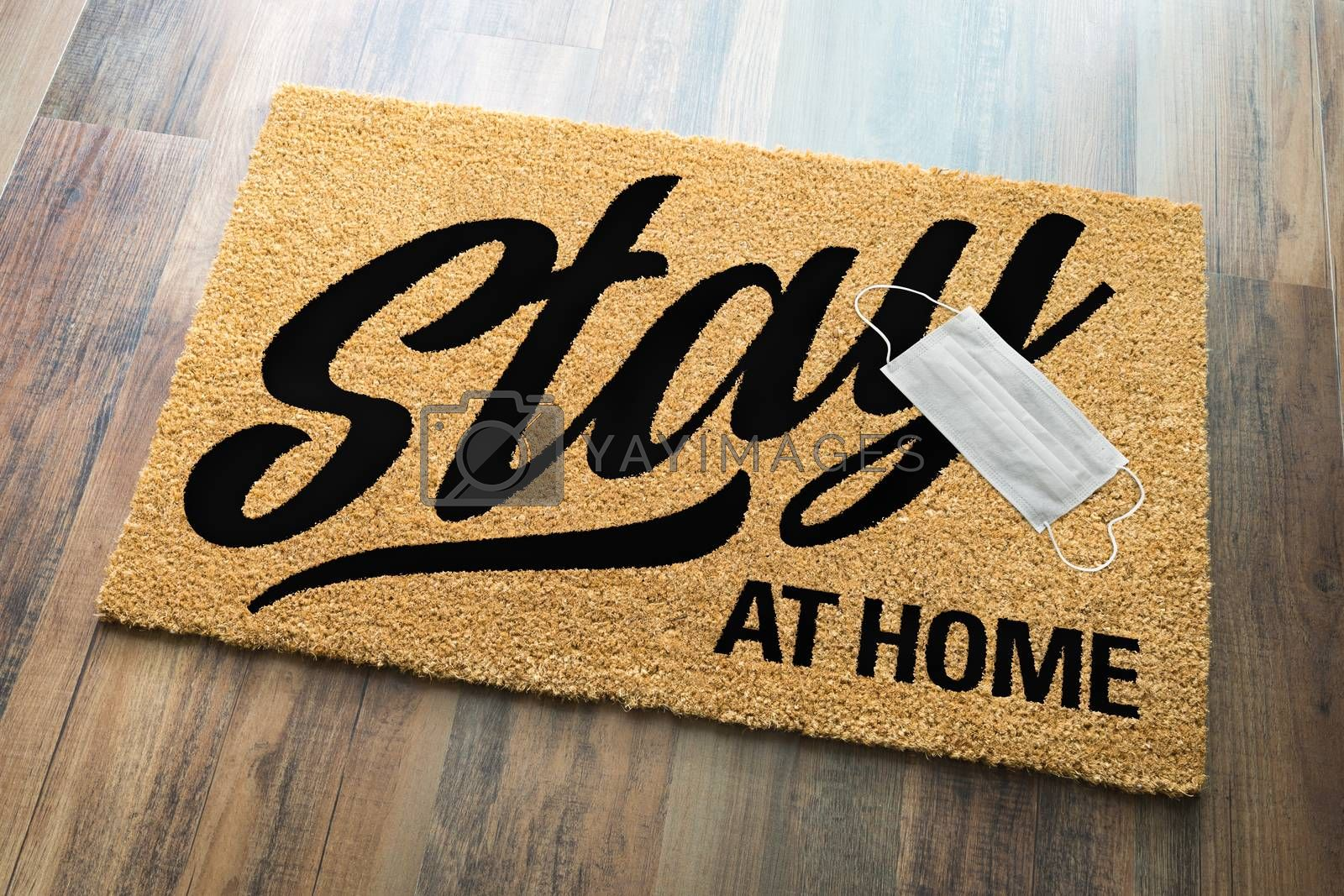 Stay At Home Welcome Mat with Medical Face Face Resting On Floor.