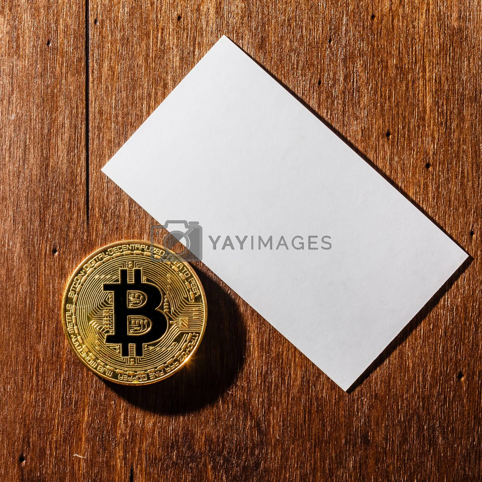 We accept bitcoins Business cards. Stack of blank horizontal business cards propped up another.
