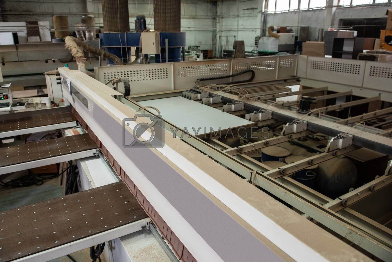 Wooden furniture production. Industrial cutting machine for automatic wood cutting