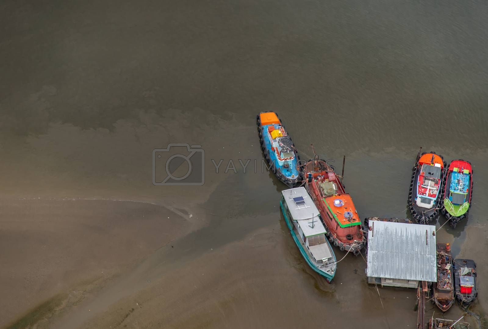 Bangkok, Thailand - May 11, 2020 : Many boats docked in the Chao Phraya River in the evening, Top view. Selective focus.
