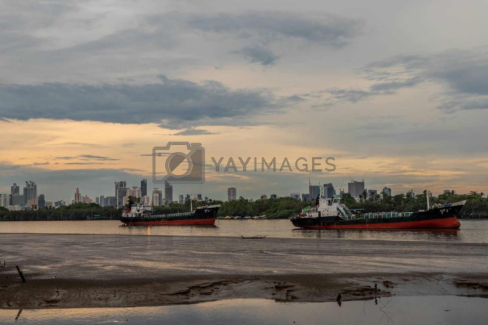 Two cargo ship parked in the middle of the Chao phraya river on by tosirikul