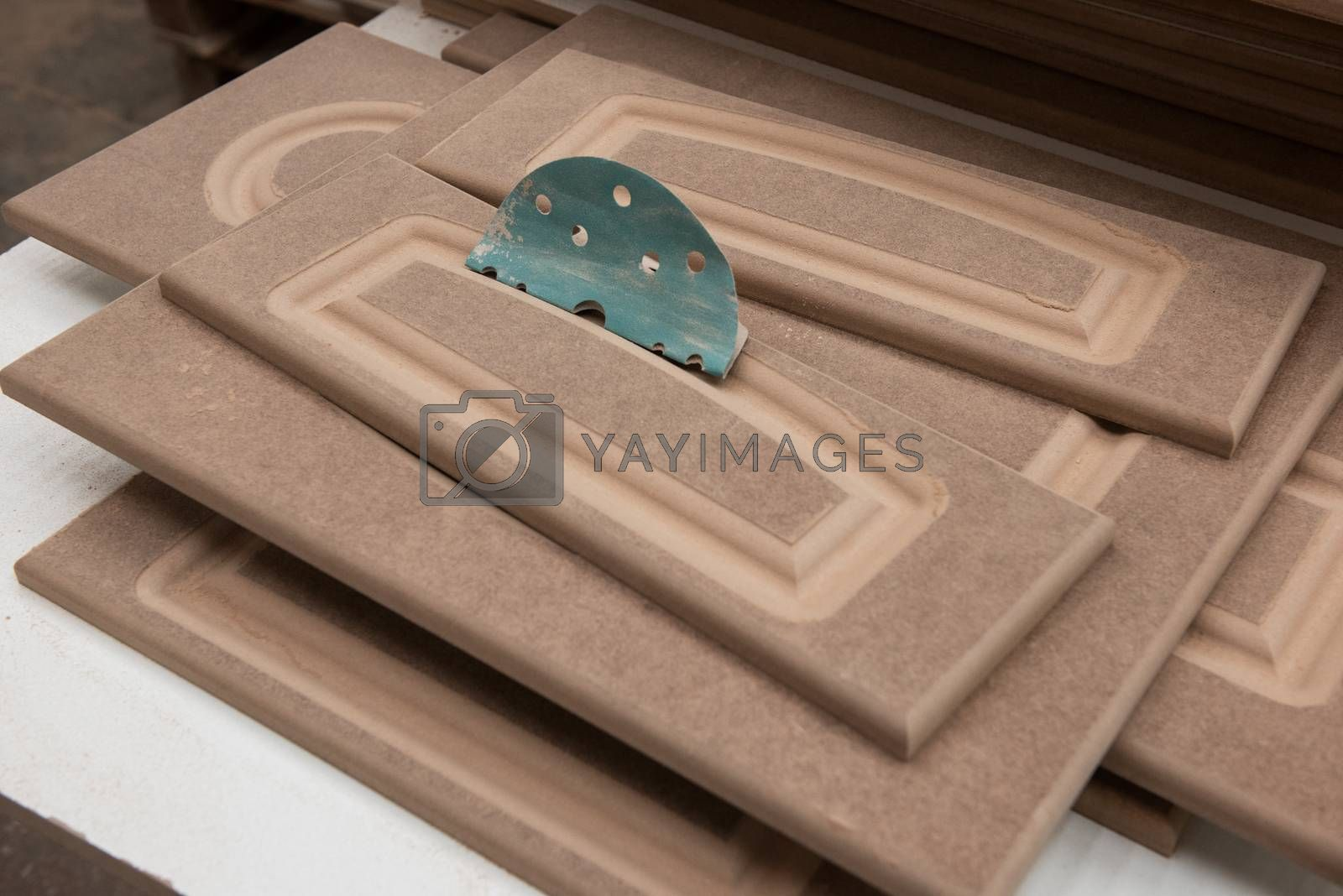Wooden furniture production. Wooden surface of the furniture facade
