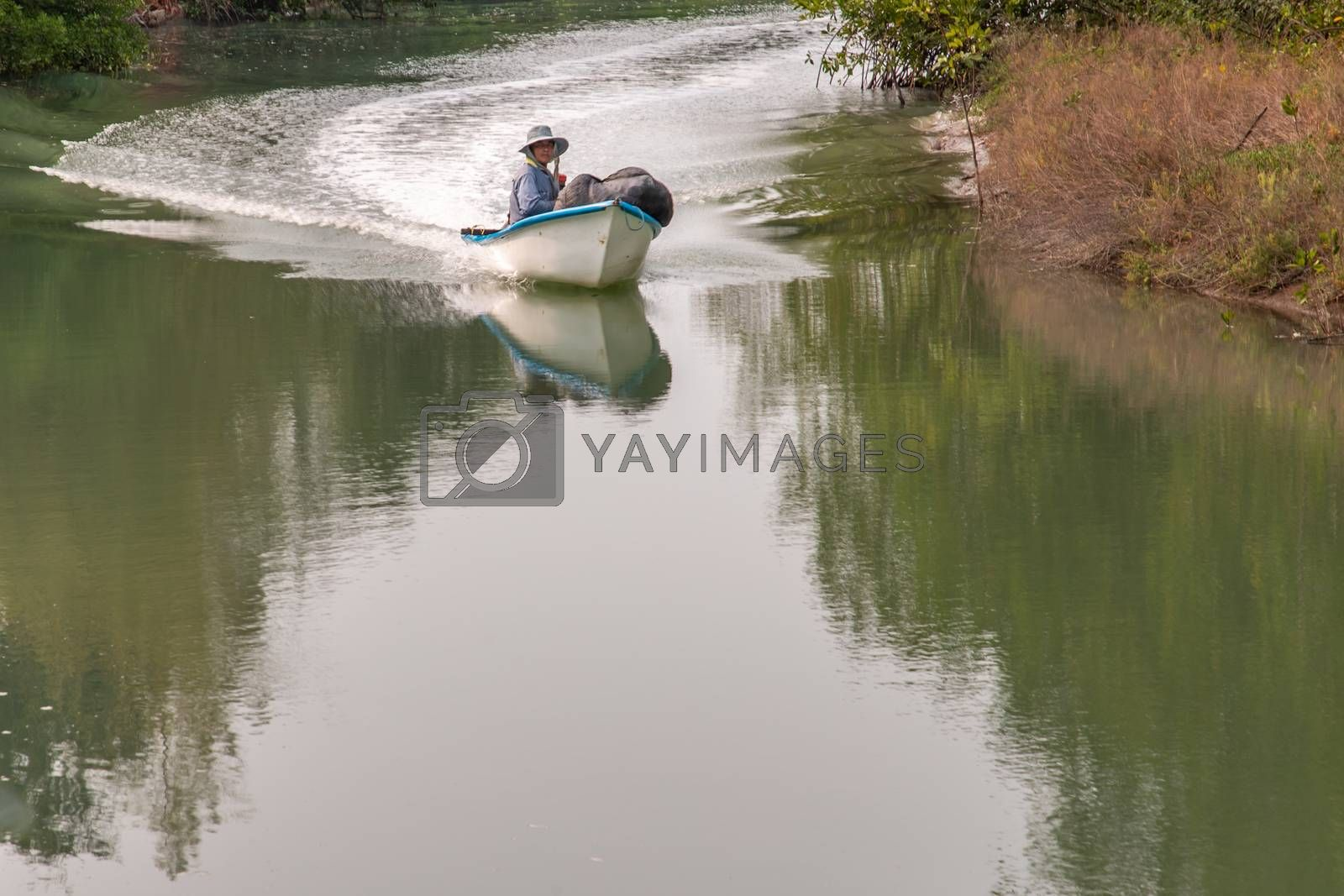 Phetchaburi,Thailand - Mar 15, 2020 : Motorboat driver on the canal. Mechanical boats and transport drivers and water traffic. No focus, specifically.