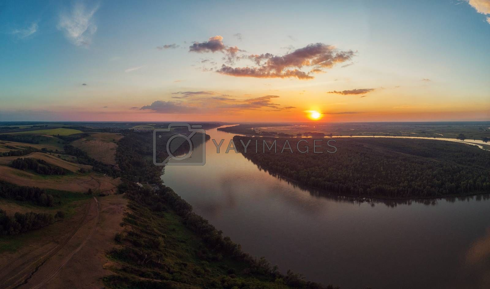Aerial drone view of river landscape in sunny summer evening by rusak