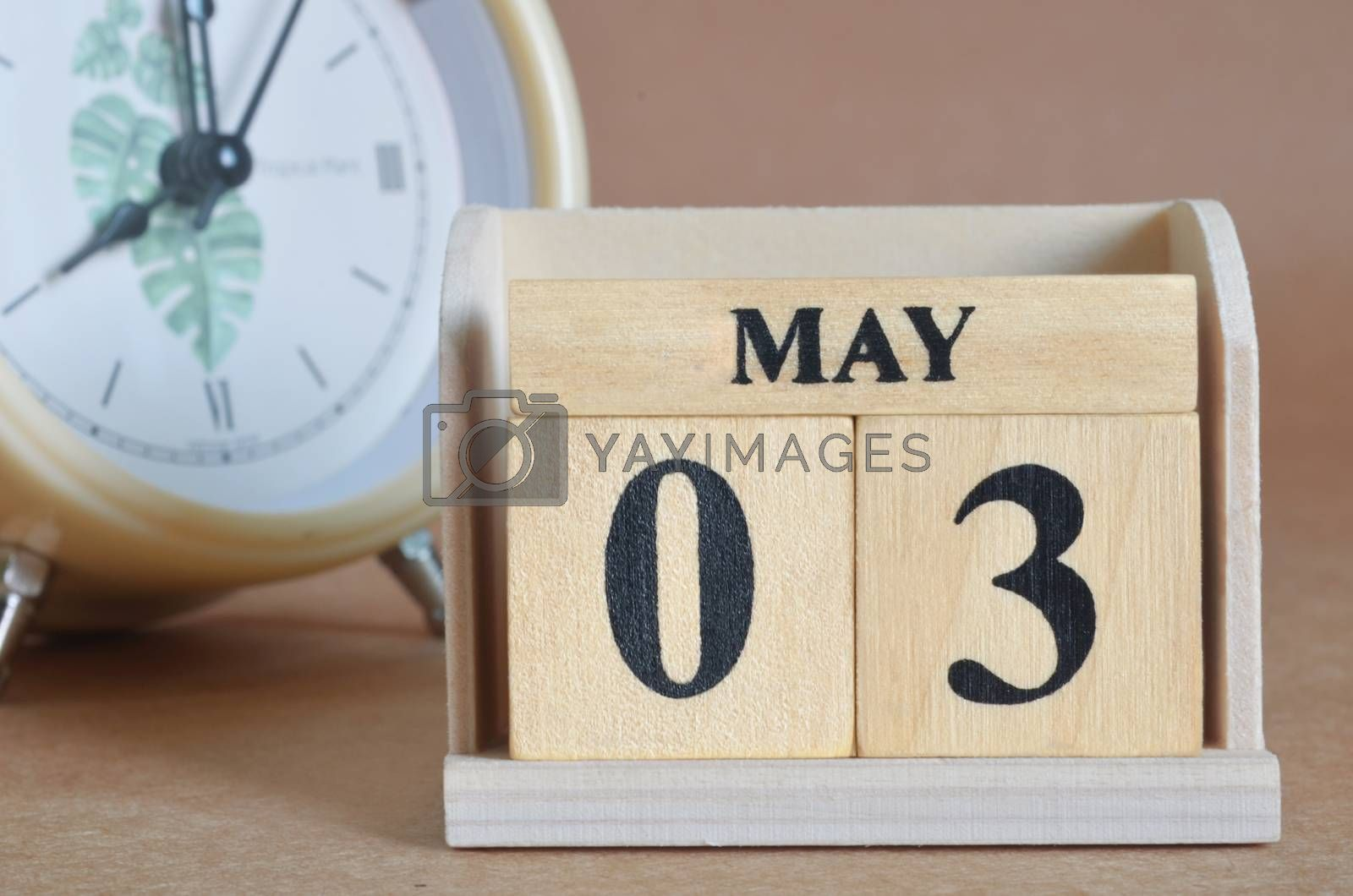 May 3, Cover design with clock in natural concept.
