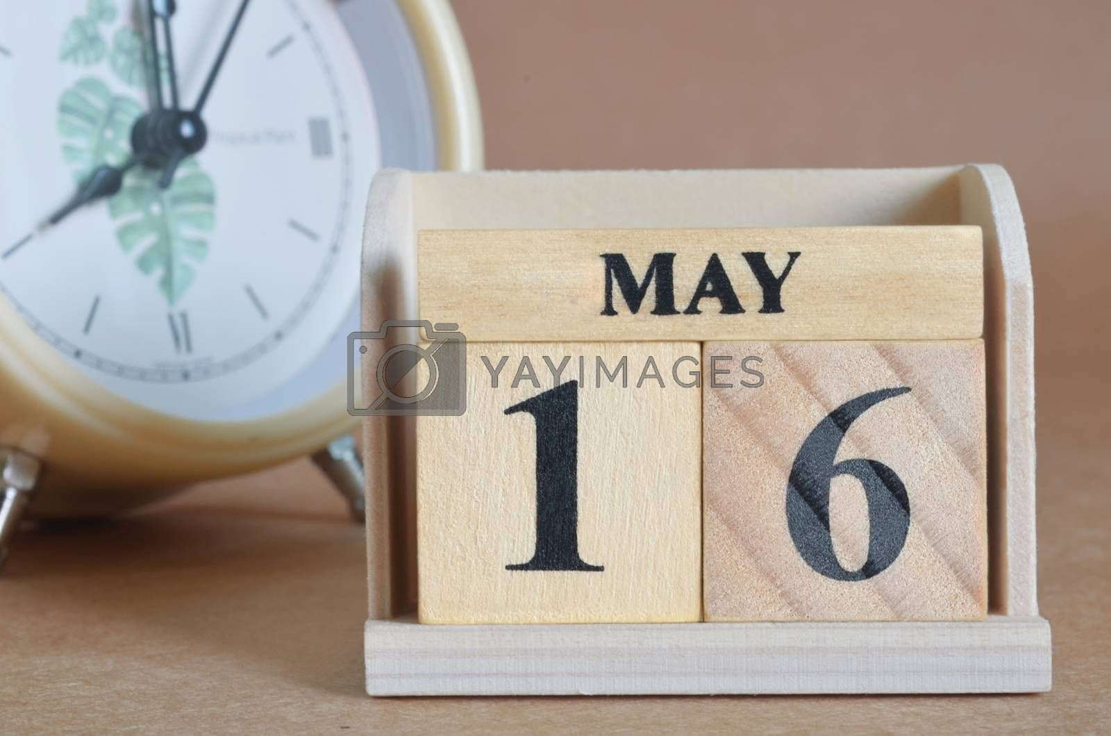 May 16, Cover design with clock in natural concept.