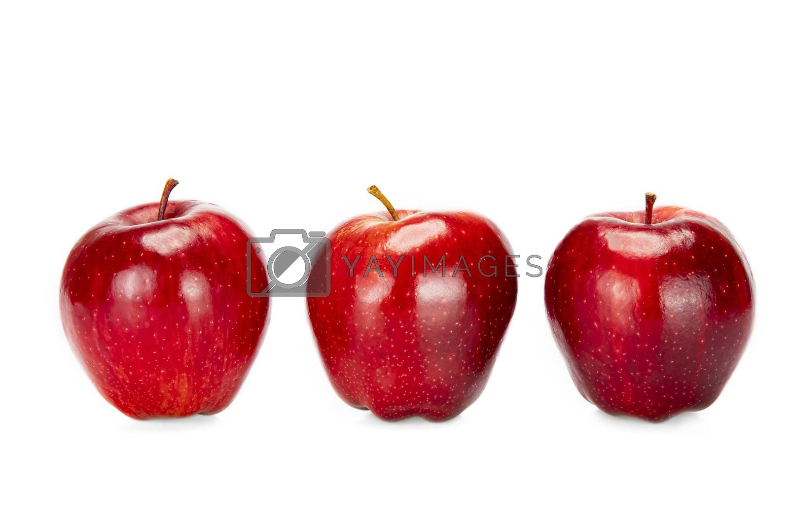 Three red apples, isolated on white background.