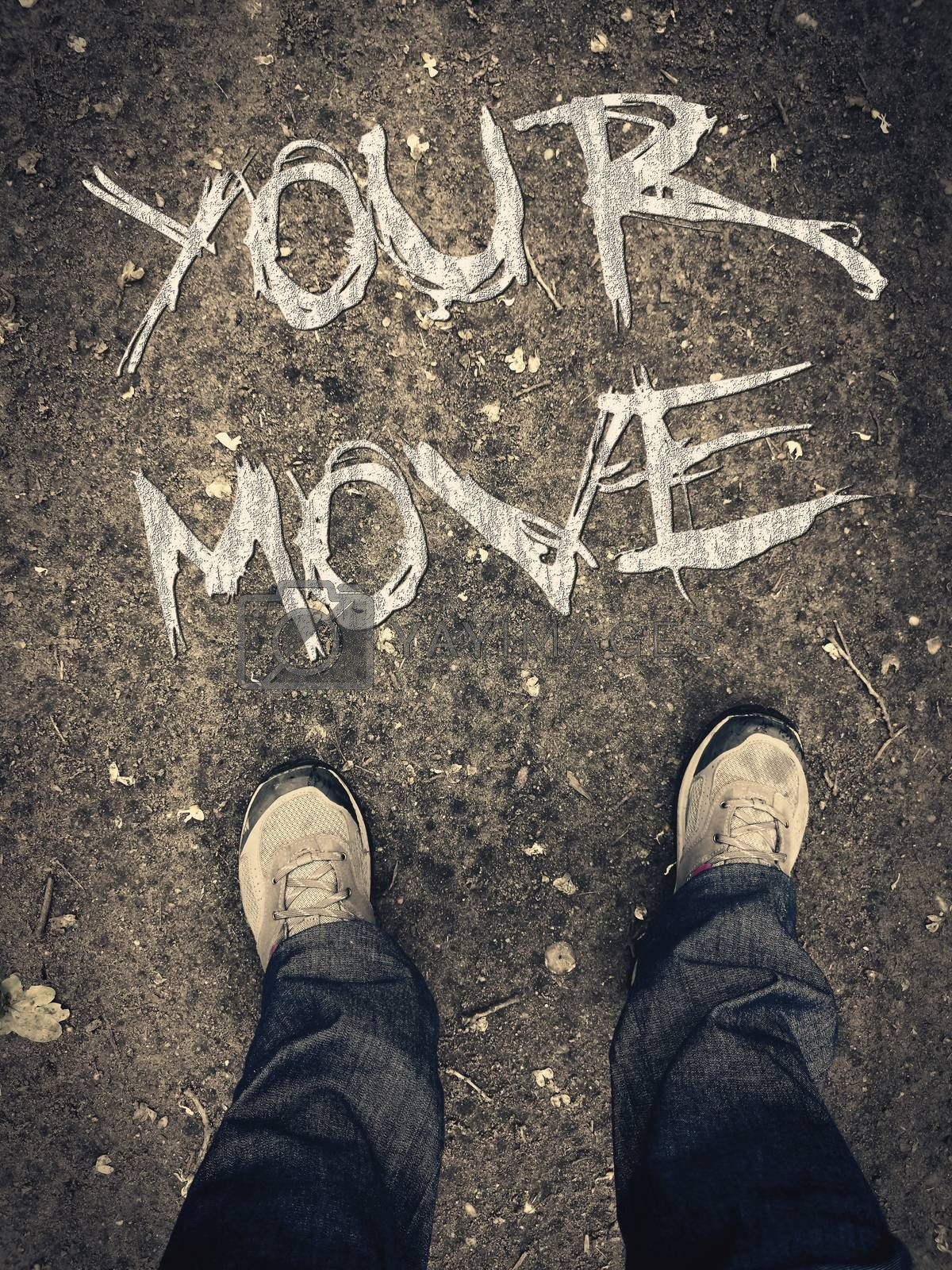 """Motivation poster with lettering words """"your move"""". Legs in shoes top view. Conceptual written message for moving forward. First person view of boots on the ground. Grunge motivational writing."""