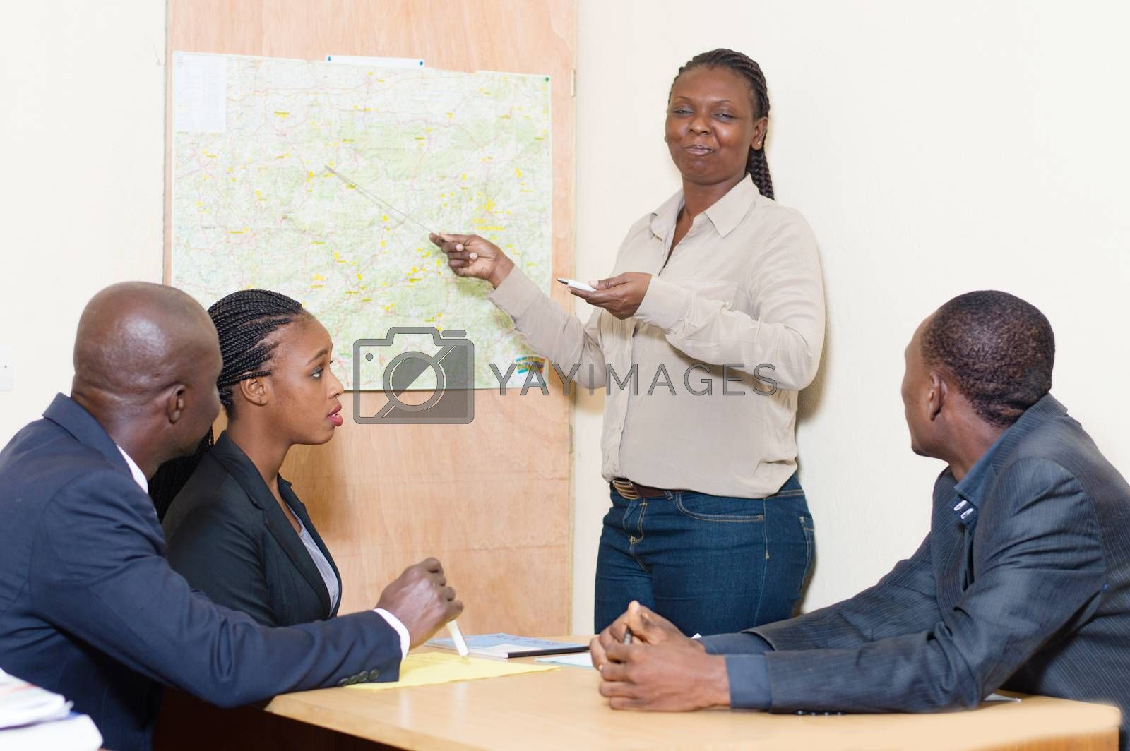 Businesswoman makes a presentation at the office at a meeting at by vystek