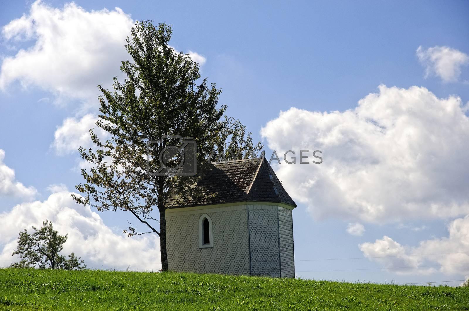Chapel in Germany on green field with blue sky