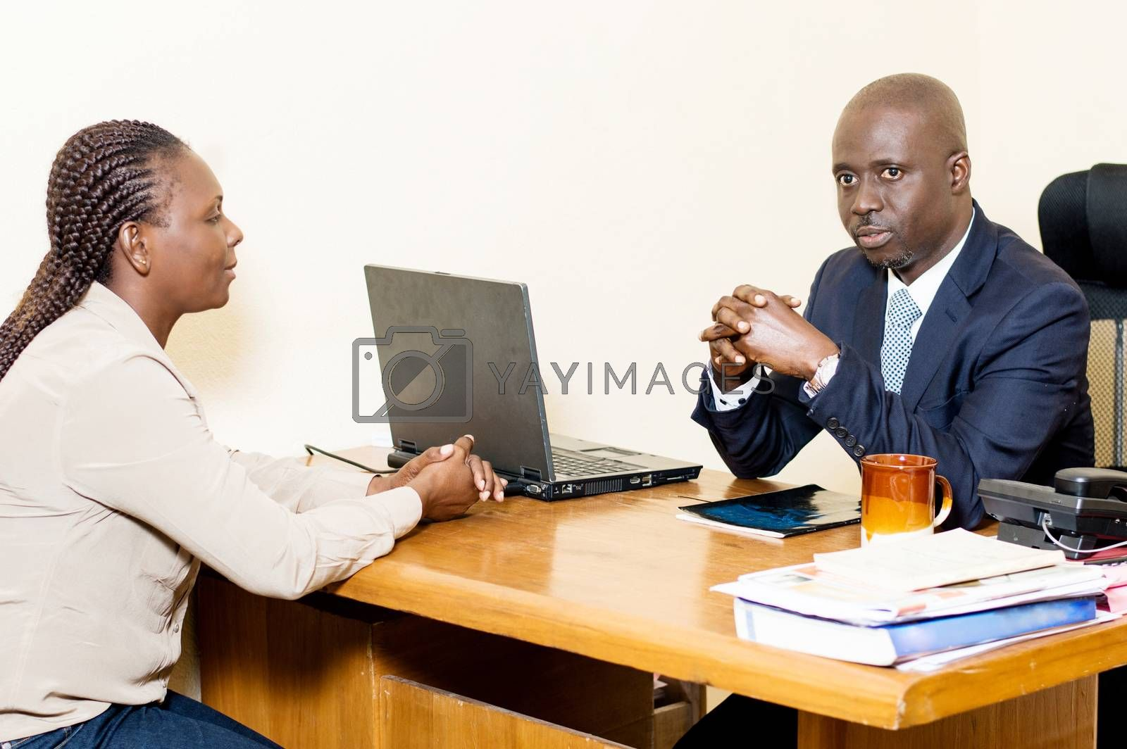 Two business people sitting face to face discusses at the office.