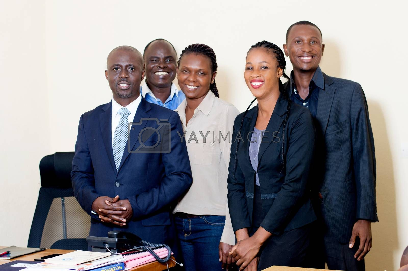 Group of happy business people posing together at the office. by vystekimages