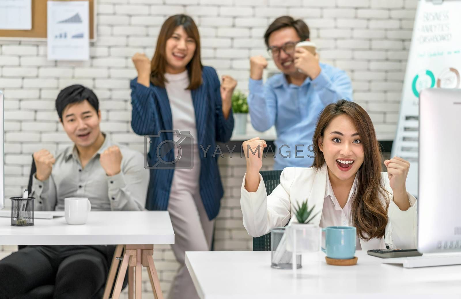 Group Of Asian Business people celebrating and showing thumbs up together with happiness action and in the modern Office, Project succeed and teamwork successful, people business group concept
