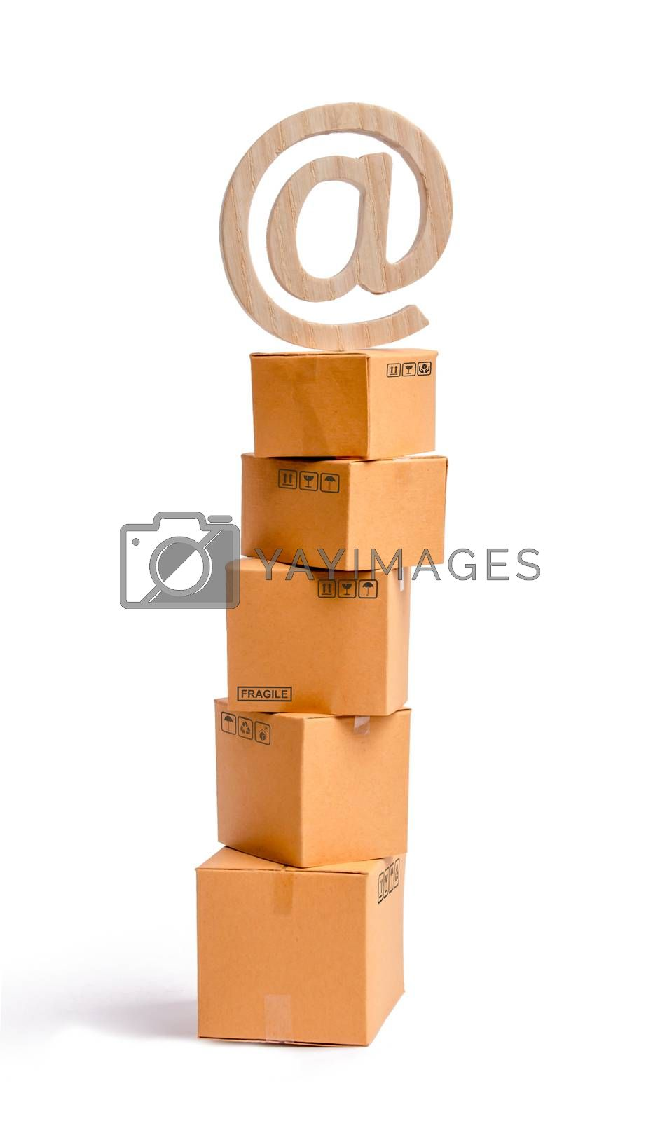 A tower of cardboard boxes and an email symbol on top. The concept of online sales, shopping and online shopping. Realization of goods and services through the Internet. buying and selling goods