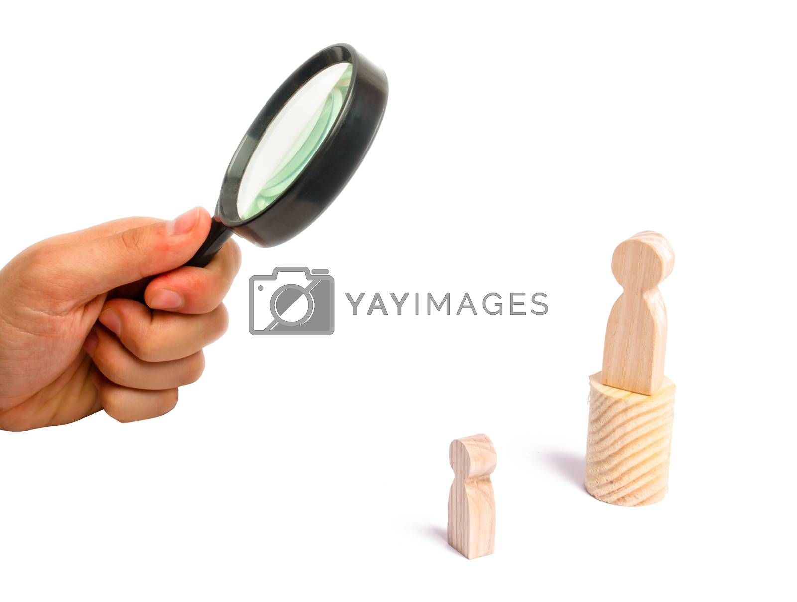 Magnifying glass is looking at the men stands on the podium and broadcasts his thoughts and ideas to listeners. The person gives orders, the leader, the boss.