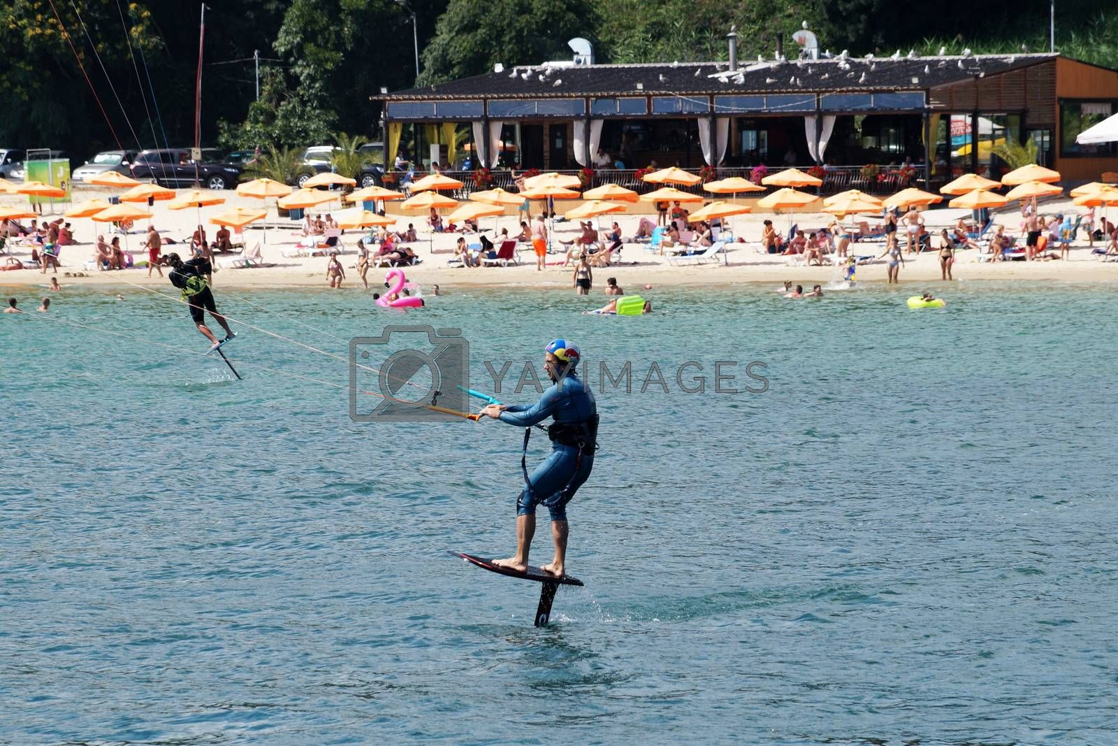 Varna, Bulgaria - July, 19, 2020: a man is kiting the sea against the background of the beachVarna