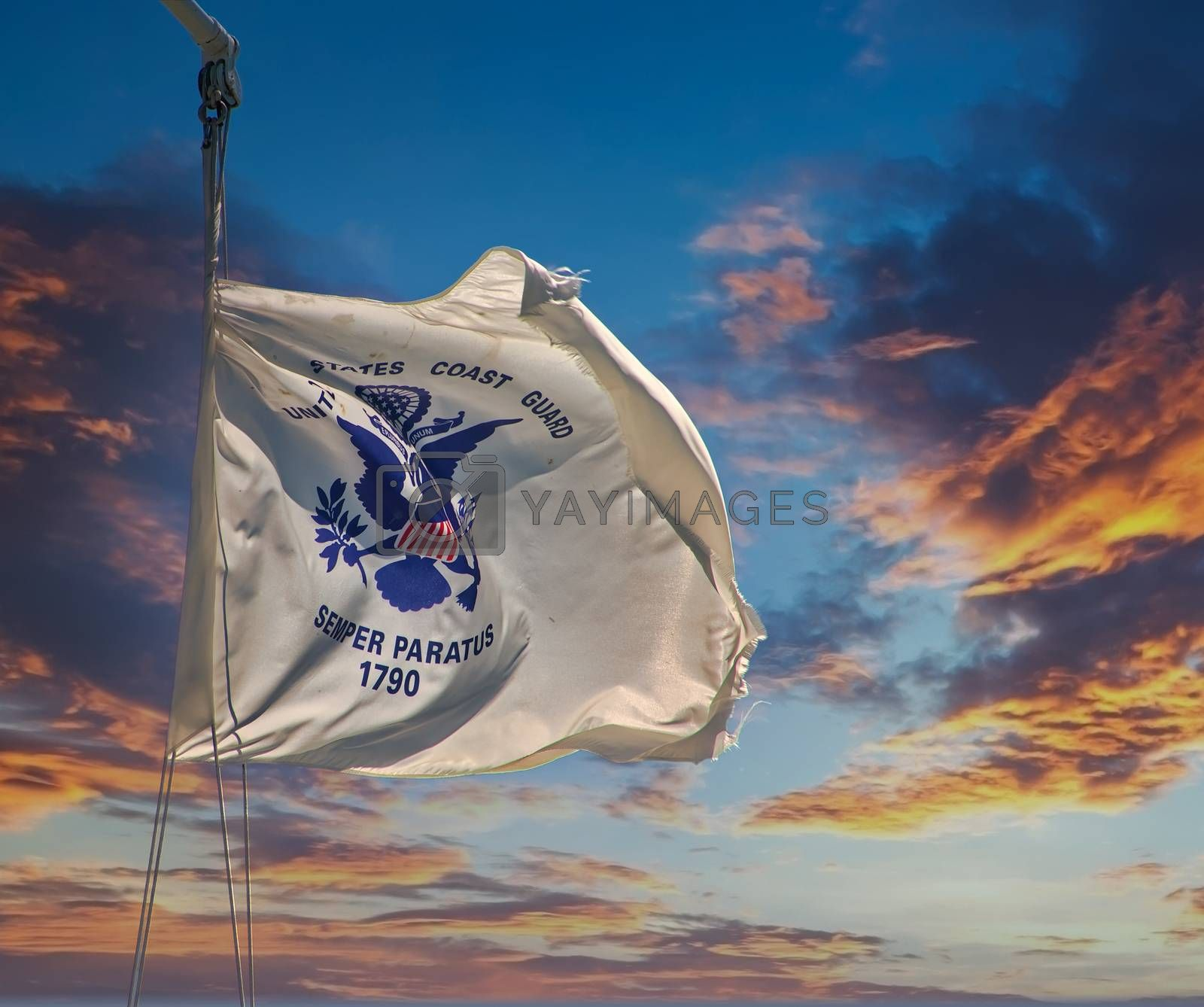 The United States Coast Guard Flag Blowing on a Blue Sky