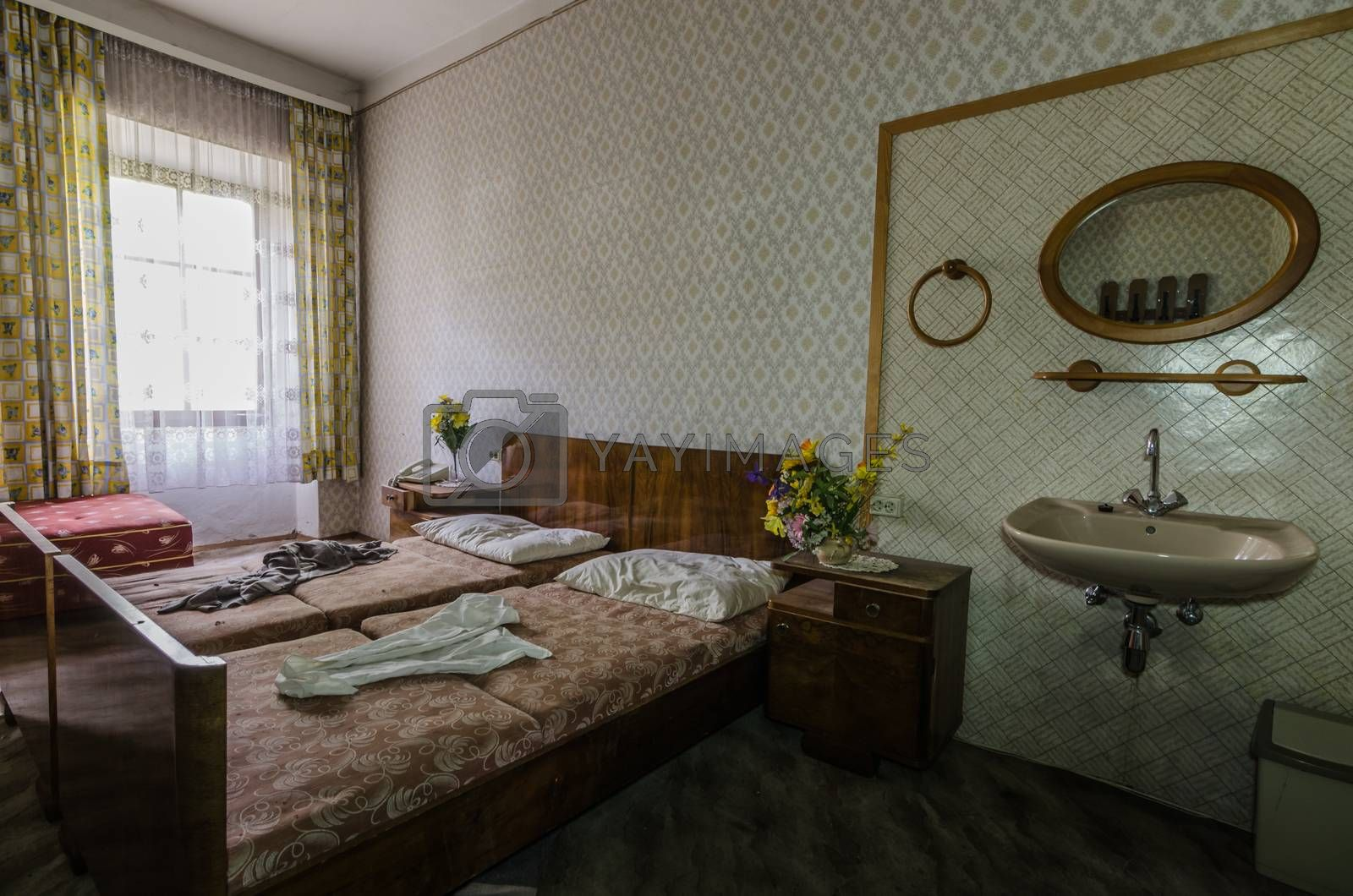 room with bed and mirror from a hotel by thomaseder