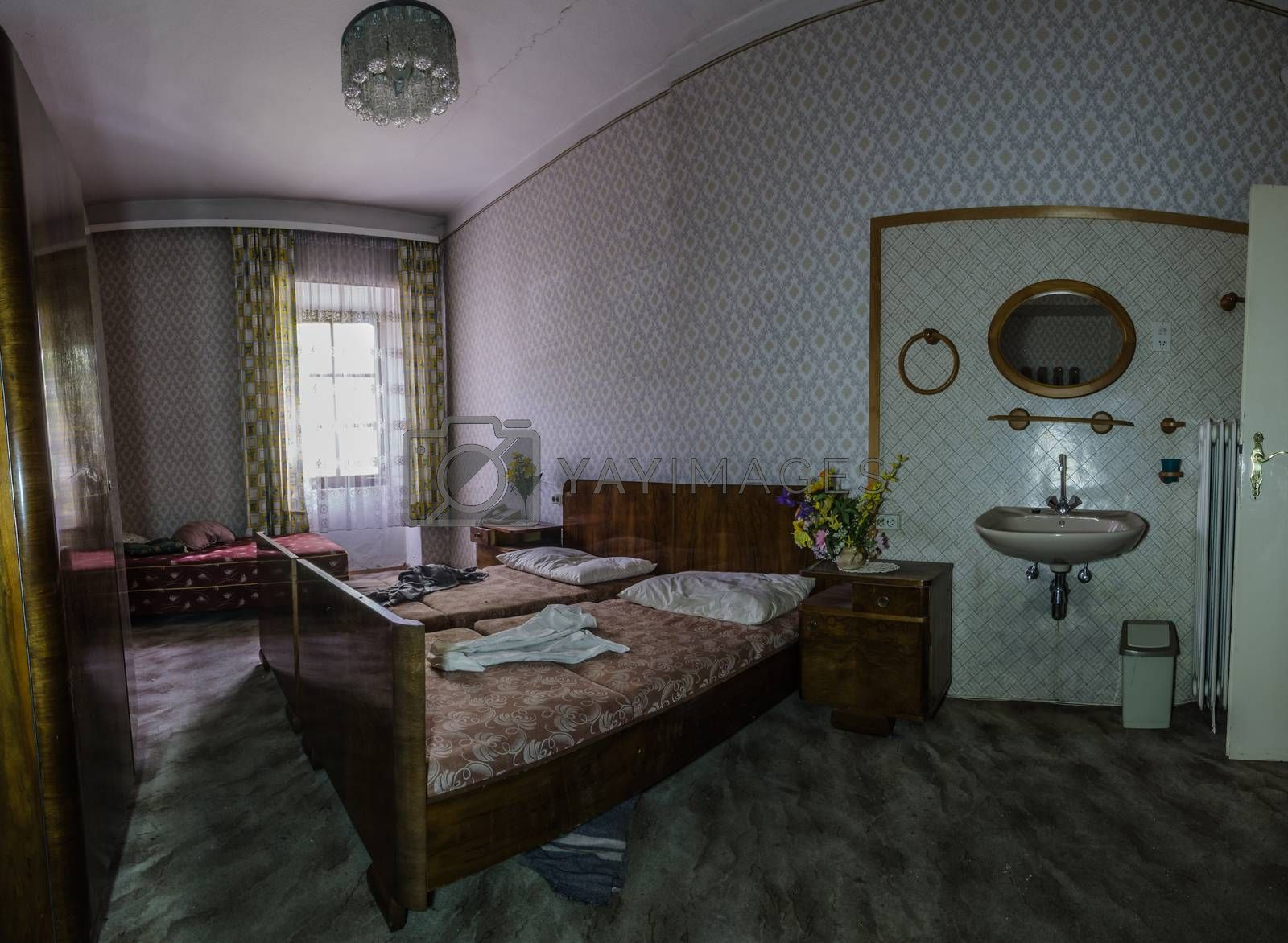 room with bed and mirror in a hotel panorama by thomaseder