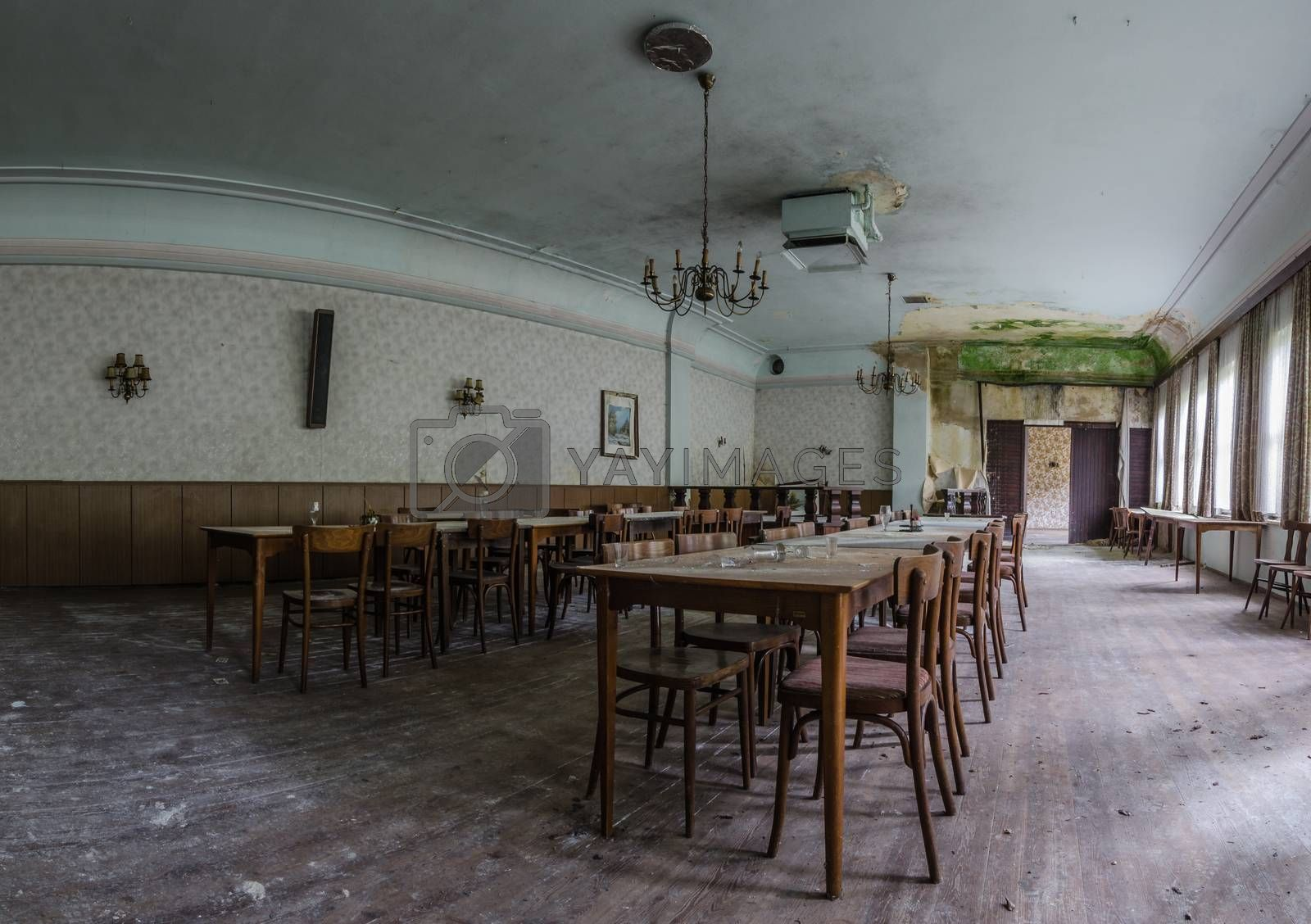 many armchairs and tables in abandoned inn panorama view