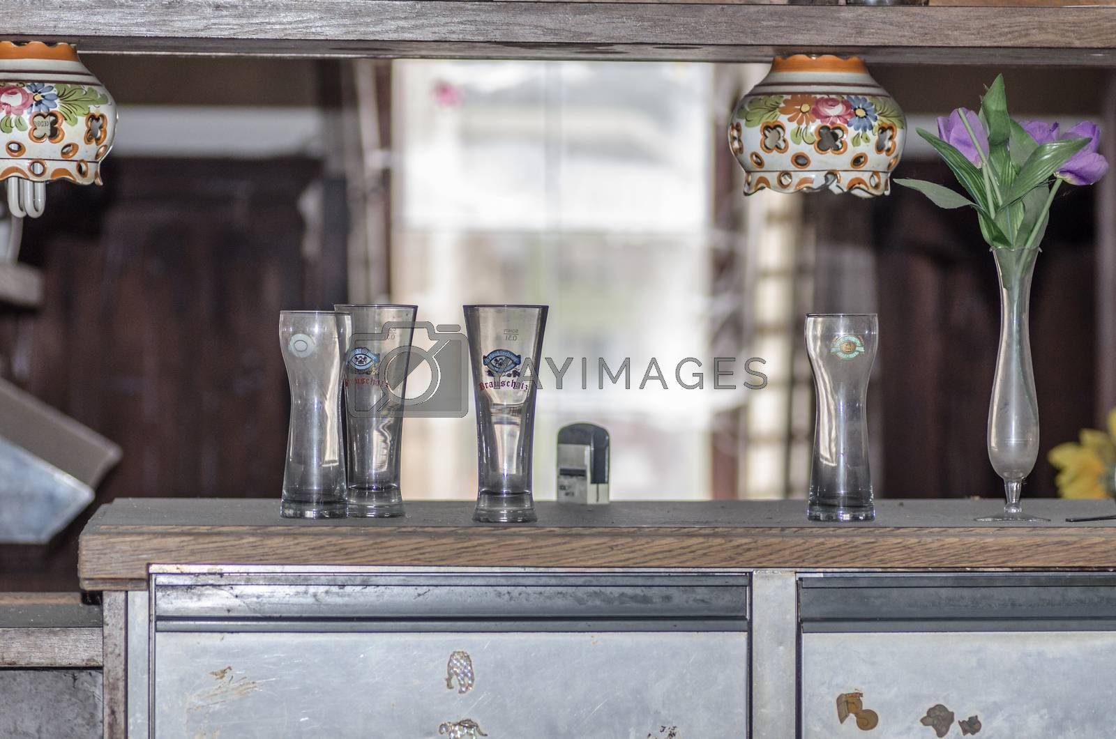 Glasses on a bar of restaurant by thomaseder