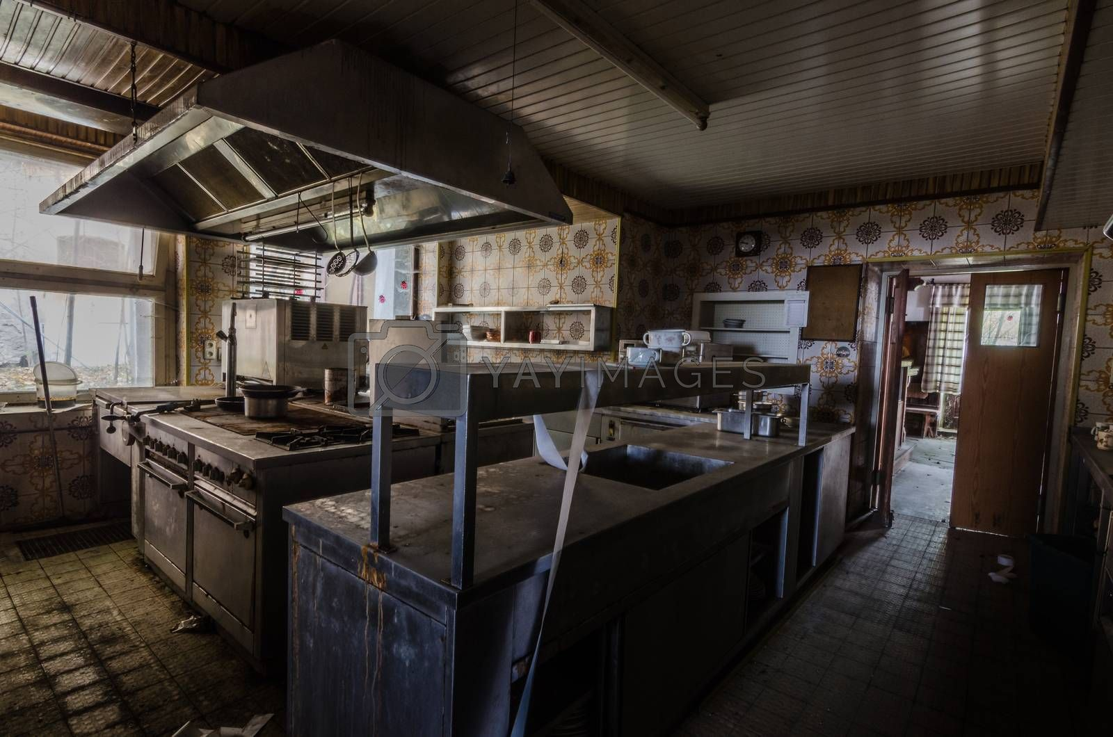 dark kitchen in old abandoned guest house