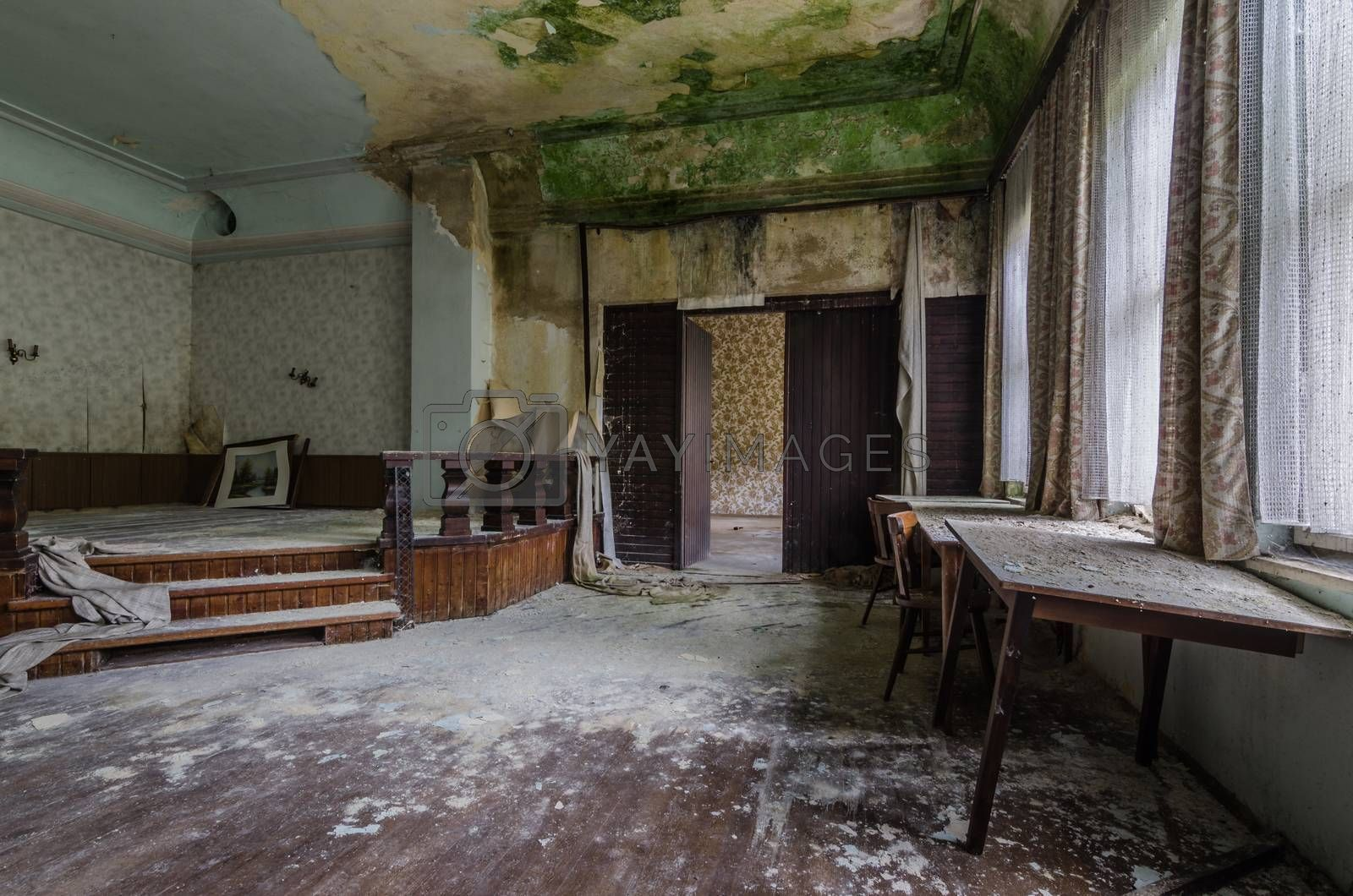 stage with green mold in a guest house by thomaseder