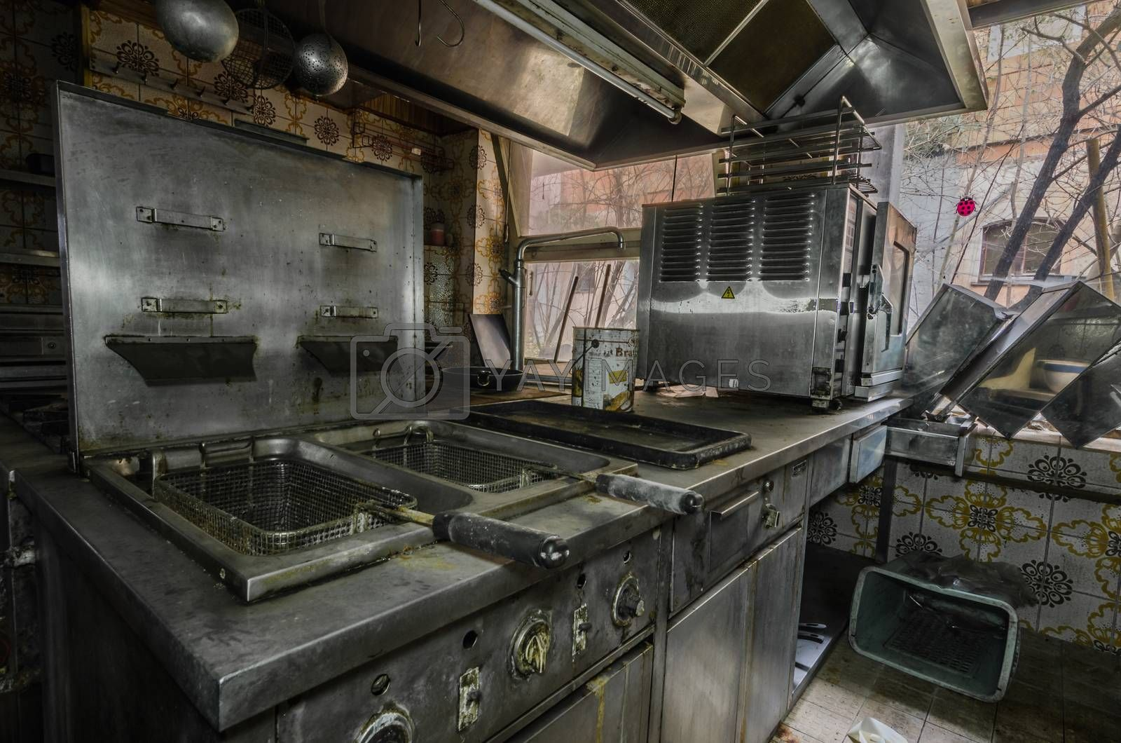 Old fryer in a kitchen by thomaseder