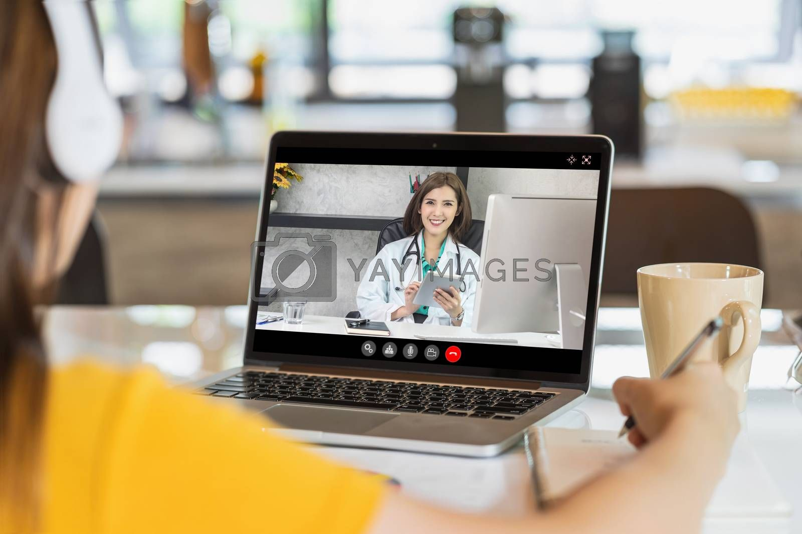 Rear View of Asian Business woman discussing with doctor to follow up the sickness in video conference when Coronavirus outbreak, Covid-19 pandemic, online adult counselling and new normal concept