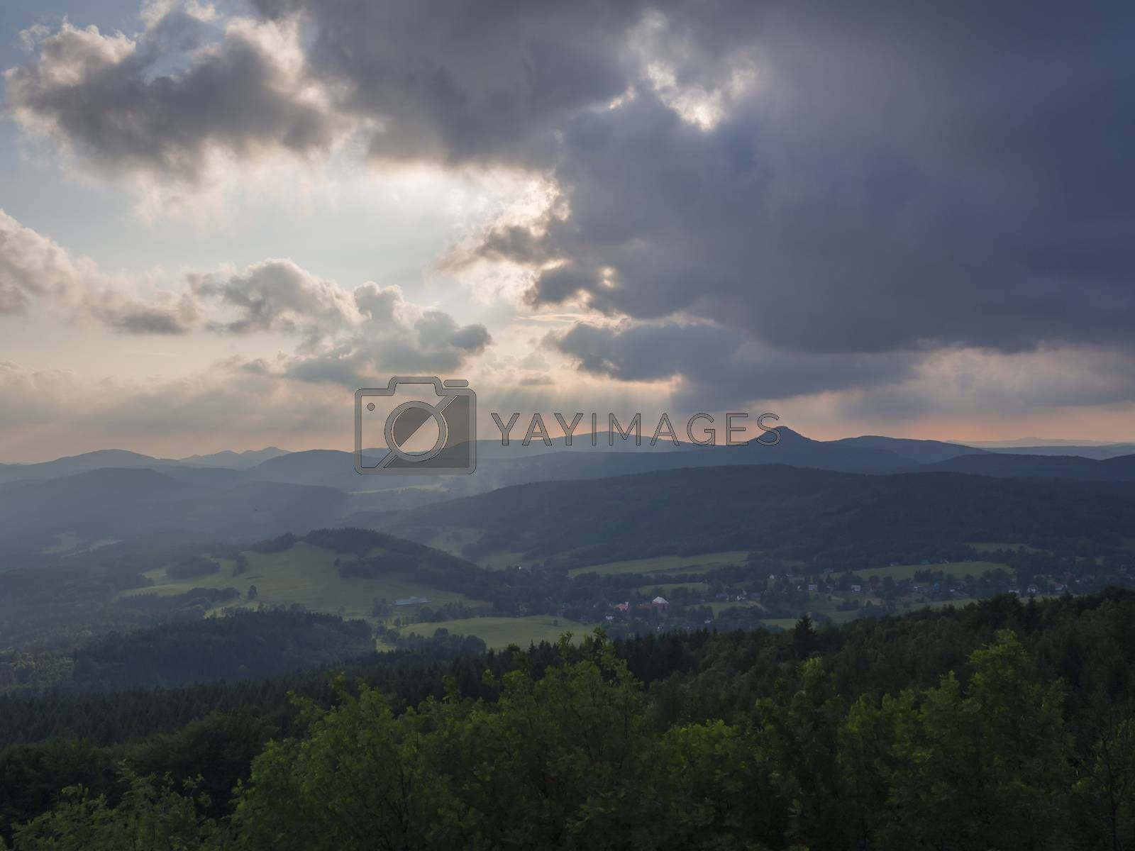 Lusatian Mountains (luzicke hory) panorama,view from Hochwald (Hvozd) mountain on czech german borders with sun rays blue green hills forest and pink cloudy sunset sky background