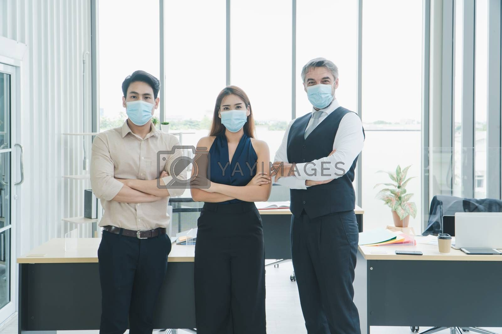 portrait Multi-ethnic male and female business group Everyone is wearing a medical mask. Smile and look at the camera. social distancing is the new normal. Background for laptops and office desks