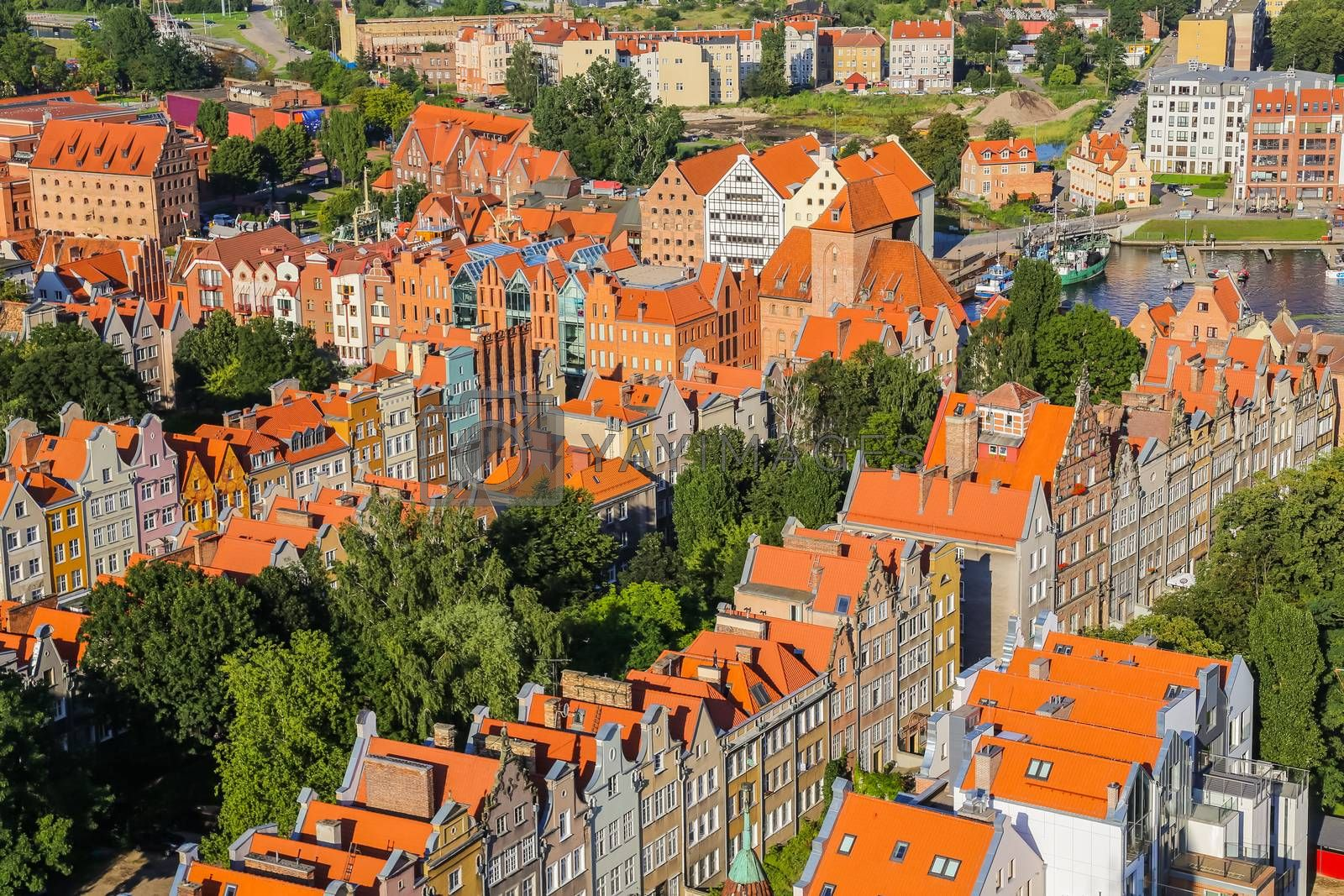 Aerial view of old historical town centre with typical colorful houses buildings, tiled roofs, Gdansk, Poland