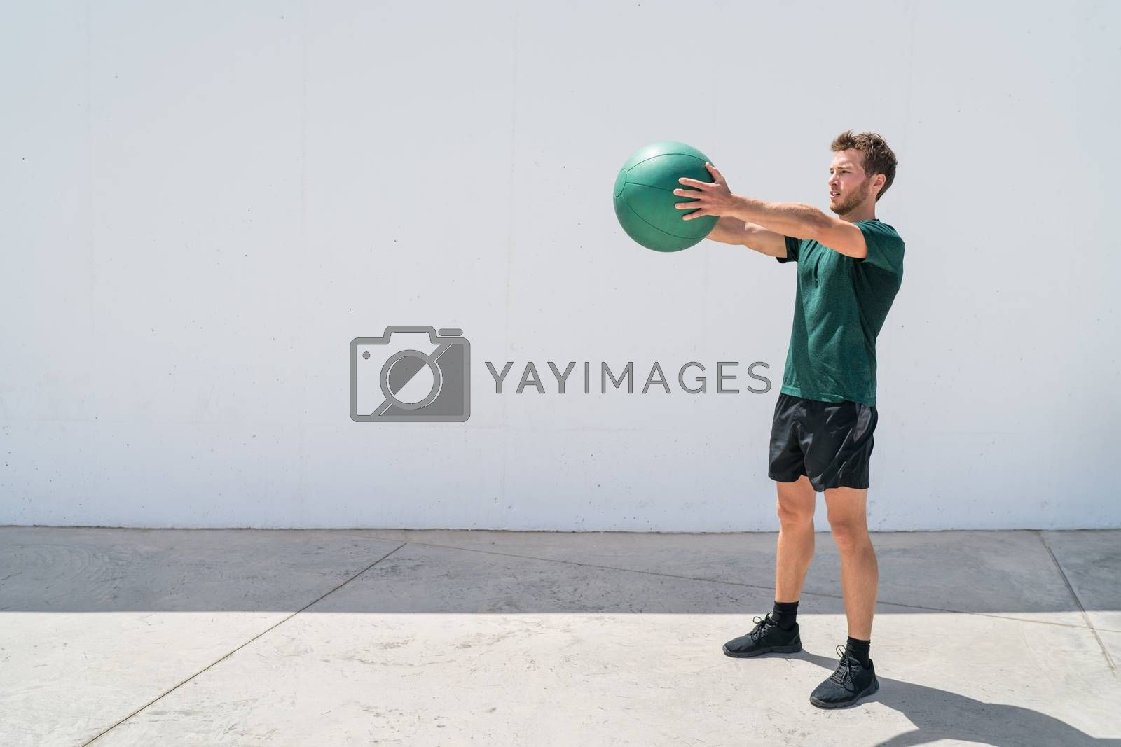 Medicine ball workout fitness man training arms by Maridav