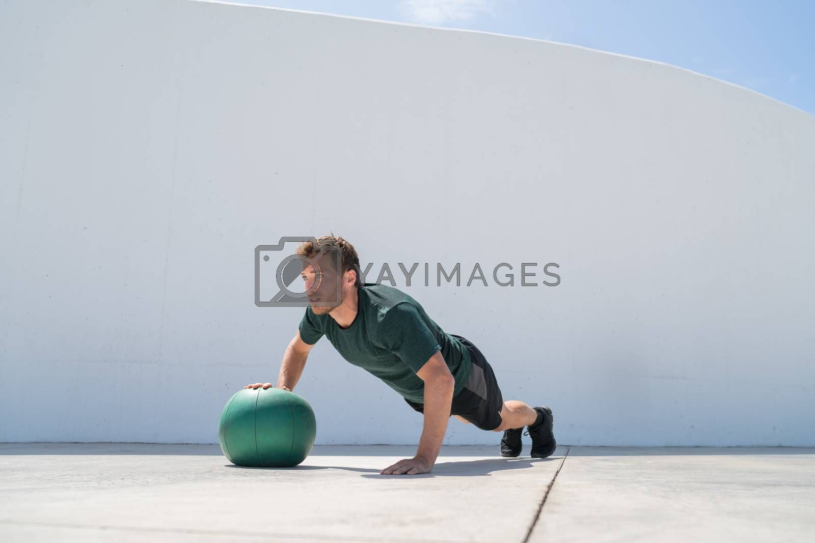 Fitness man strength training pushup medicine ball by Maridav