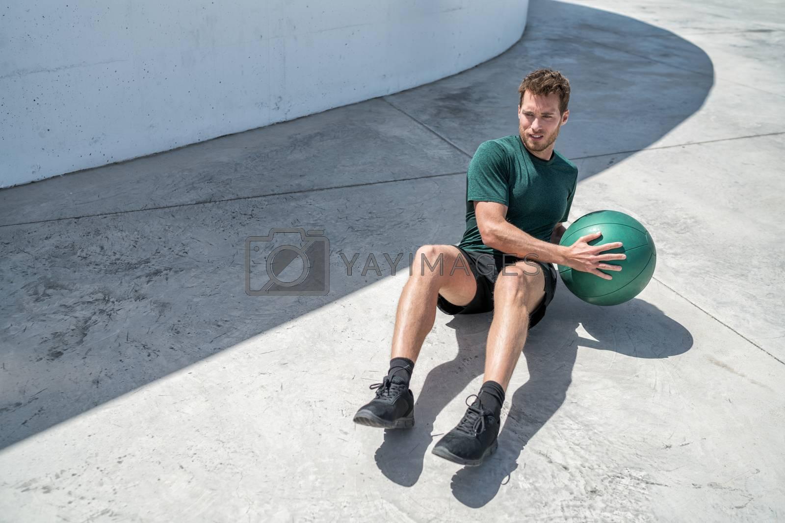 Medicine ball russian twist exercise fitness man by Maridav