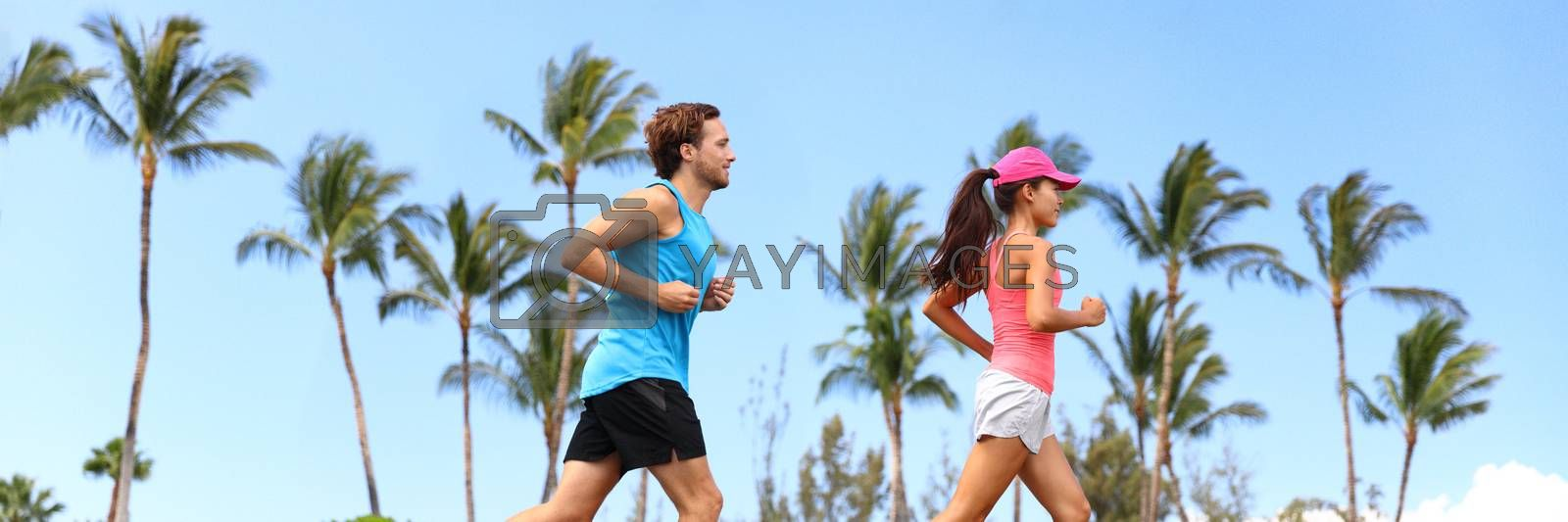 Healthy runners couple running lifestyle banner. Sport fitness people jogging together in summer park outdoors. Horizontal landscape with palm trees background.