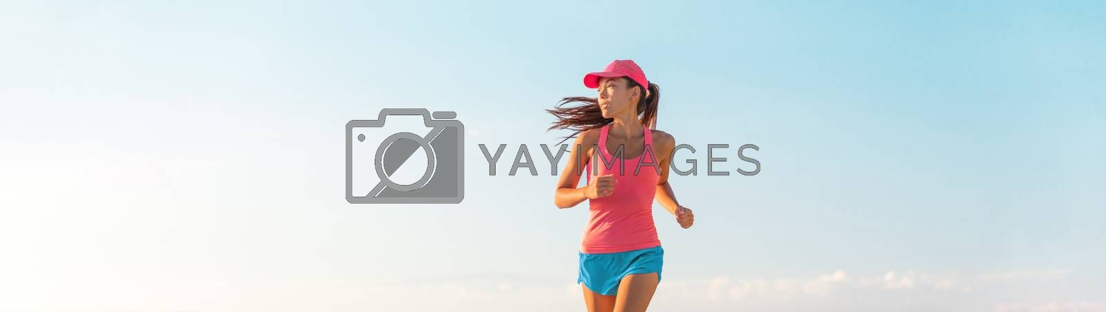 People lifestyle banner healthy woman running. Blue sky copyspace.